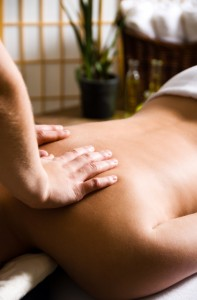 woman getting a good massage at a day spa